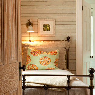 Example of a cottage chic bedroom design in Atlanta with beige walls