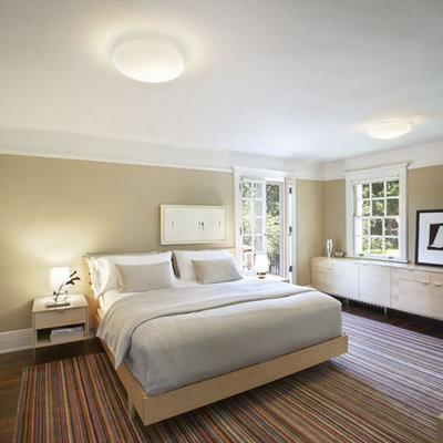 Inspiration for a large modern master dark wood floor bedroom remodel in New York with beige walls