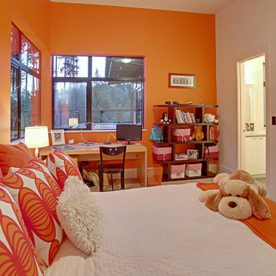 Inspiration for a contemporary bedroom remodel in Seattle with orange walls