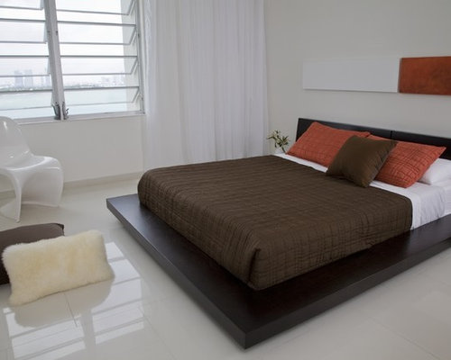 inspiration for a modern ceramic floor and white floor bedroom remodel in dc metro with white