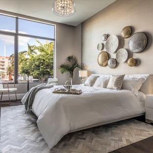 Bedroom - contemporary dark wood floor and brown floor bedroom idea in Miami with gray walls