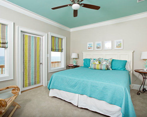 Example of a trendy gray floor bedroom design in Miami with gray walls