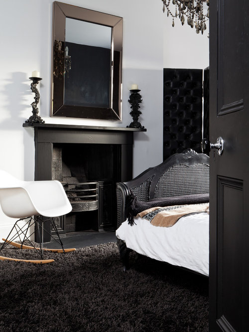 Minimalist Black Floor Bedroom Photo In Birmingham With White Walls