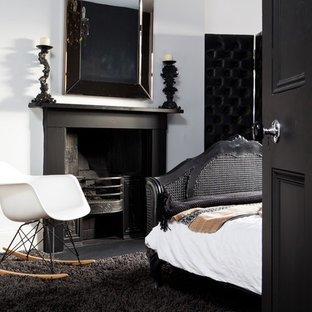 Trendy black floor bedroom photo in Birmingham with white walls