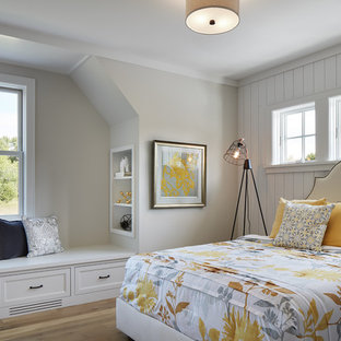 Bedroom - mid-sized farmhouse guest light wood floor and brown floor bedroom idea in Minneapolis with gray walls