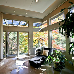 Design ideas for a large contemporary master bedroom in Baltimore with beige walls, concrete floors and brown floor.