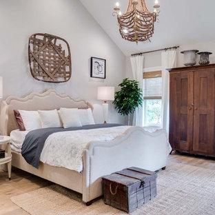 Bedroom - french country master light wood floor bedroom idea in Atlanta with gray walls