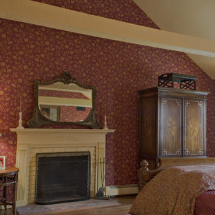 Inspiration for a large traditional master bedroom in Bridgeport with red walls, medium hardwood floors, a standard fireplace and a brick fireplace surround.