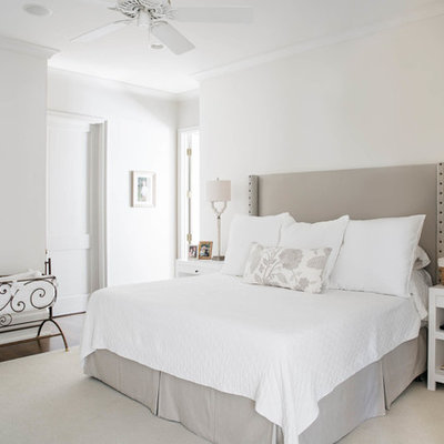 Inspiration for a large transitional master dark wood floor bedroom remodel in Miami with white walls and no fireplace