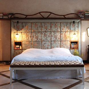 Example of an eclectic marble floor bedroom design in London