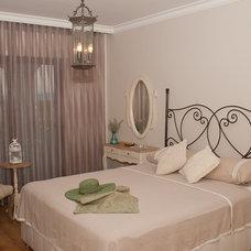 Mediterranean Bedroom by Finesse Interior Design