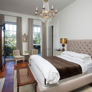 Inspiration for a timeless dark wood floor bedroom remodel in New Orleans with white walls, a standard fireplace and a stone fireplace