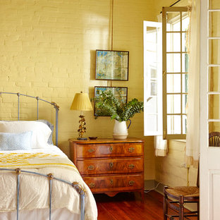 Cottage Chic Dark Wood Floor Bedroom Photo In New Orleans With Yellow Walls