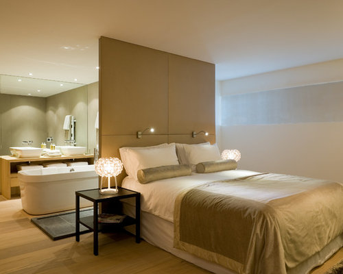 example of a large trendy master light wood floor bedroom design in other with white walls - Open Bedroom Design