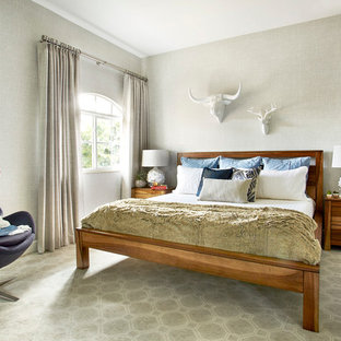 Small transitional guest carpeted bedroom photo in Miami with gray walls