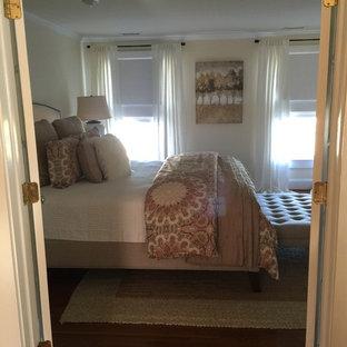 Идея дизайна: хозяйская спальня среднего размера в стиле кантри с белыми стенами, паркетным полом среднего тона и фасадом камина из штукатурки без камина