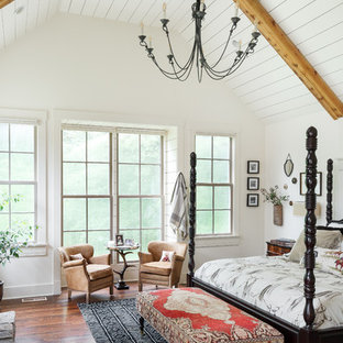 Example of a classic master dark wood floor bedroom design in Louisville with white walls