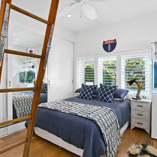Design ideas for a mid-sized transitional guest bedroom in Sydney with white walls, dark hardwood floors and brown floor.