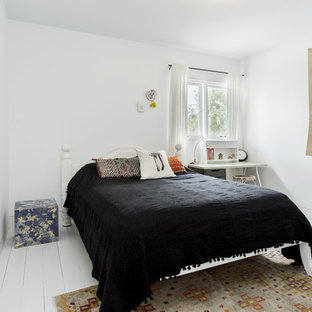 Large mediterranean guest bedroom in Sydney with white walls, painted wood floors and white floor.