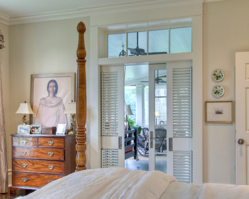 example of a country bedroom design in atlanta - Louvered Bedroom Decor