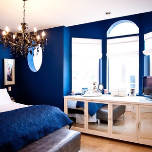 Bedroom - mid-sized transitional master porcelain floor and brown floor bedroom idea in Miami with blue walls and no fireplace