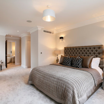 Example of a trendy master carpeted bedroom design in London with gray walls