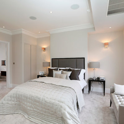 Trendy master carpeted and gray floor bedroom photo in London with gray walls