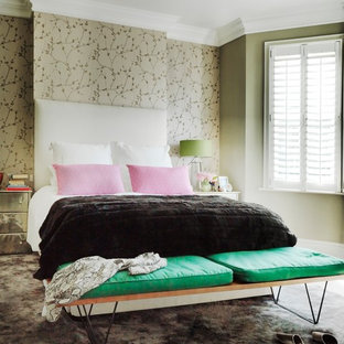 Trendy carpeted bedroom photo in London with multicolored walls
