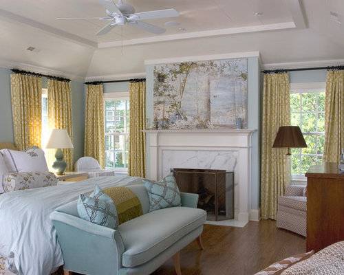 Elegant Medium Tone Wood Floor Bedroom Photo In Charlotte With Blue Walls  And A Standard Fireplace