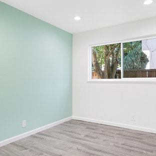 Bedroom - mid-sized transitional guest laminate floor and brown floor bedroom idea in San Francisco with blue walls and no fireplace