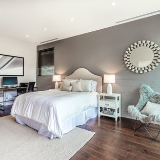 Example of a mid-sized transitional guest dark wood floor and brown floor bedroom design in Los Angeles with white walls, no fireplace and a concrete fireplace