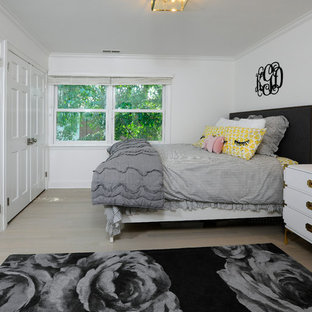 Bedroom - small transitional light wood floor and beige floor bedroom idea in New York with white walls