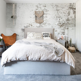 Example of a cottage chic carpeted and gray floor bedroom design in Melbourne with white walls