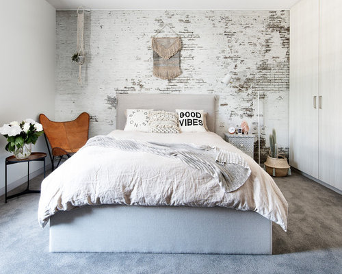 Photo Of A Vintage Bedroom In Melbourne With White Walls, Carpet And Grey  Floors.