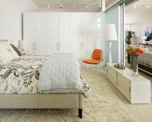 danish bedroom photo in los angeles with white walls and light hardwood floors