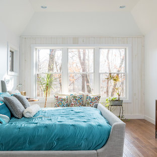 88f279592 Example of an eclectic guest medium tone wood floor bedroom design in Grand  Rapids with white