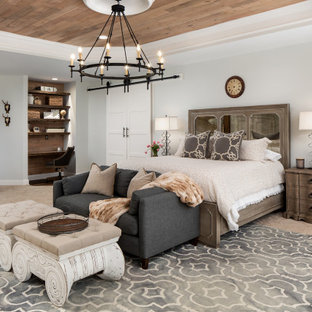 Transitional bedroom in DC Metro with white walls, carpet, beige floor, recessed and wood.