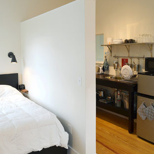 Inspiration for a small transitional master dark wood floor and brown floor bedroom remodel in Portland Maine with white walls and no fireplace