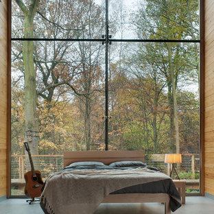 Immagine di una camera da letto minimalista con nessun camino