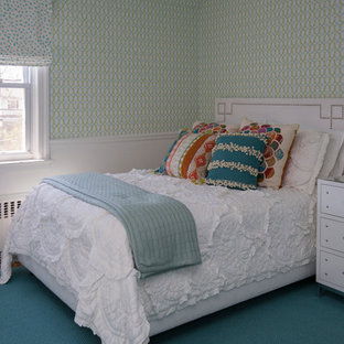 Example of a large transitional guest carpeted and green floor bedroom design in New York with green walls