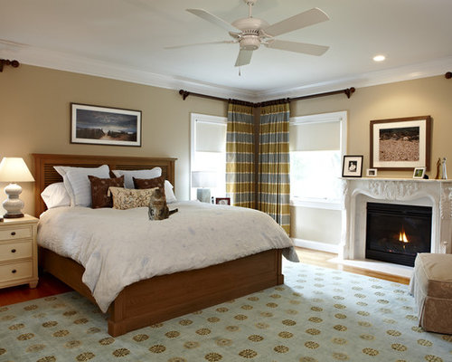 traditional bedroom idea in dc metro with beige walls and a standard fireplace