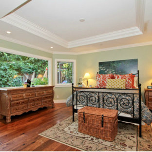 Large elegant master medium tone wood floor bedroom photo in San Francisco with gray walls and no fireplace