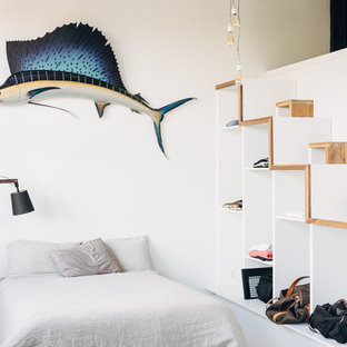 Design ideas for a scandinavian loft-style bedroom in Montreal with white walls.