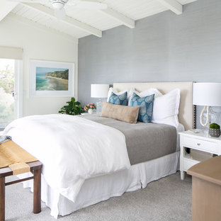 Beach style master carpeted and gray floor bedroom photo in Orange County with gray walls