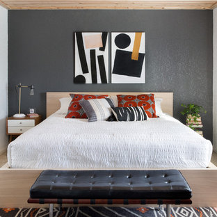 Example of an eclectic carpeted and beige floor bedroom design in Austin with gray walls