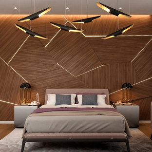 Example of a mid-sized minimalist master light wood floor and brown floor bedroom design with brown walls