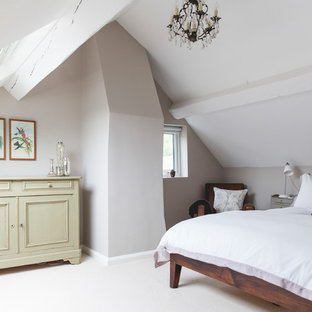 Country bedroom in London with beige walls, carpet and white floors.