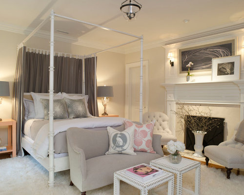 example of a bedroom design in dallas with beige walls and a standard fireplace