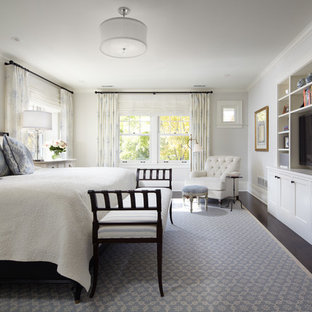 Example of a classic dark wood floor bedroom design in Minneapolis with white walls and no fireplace