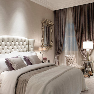 Example of a large classic guest carpeted bedroom design in London with gray walls and no fireplace